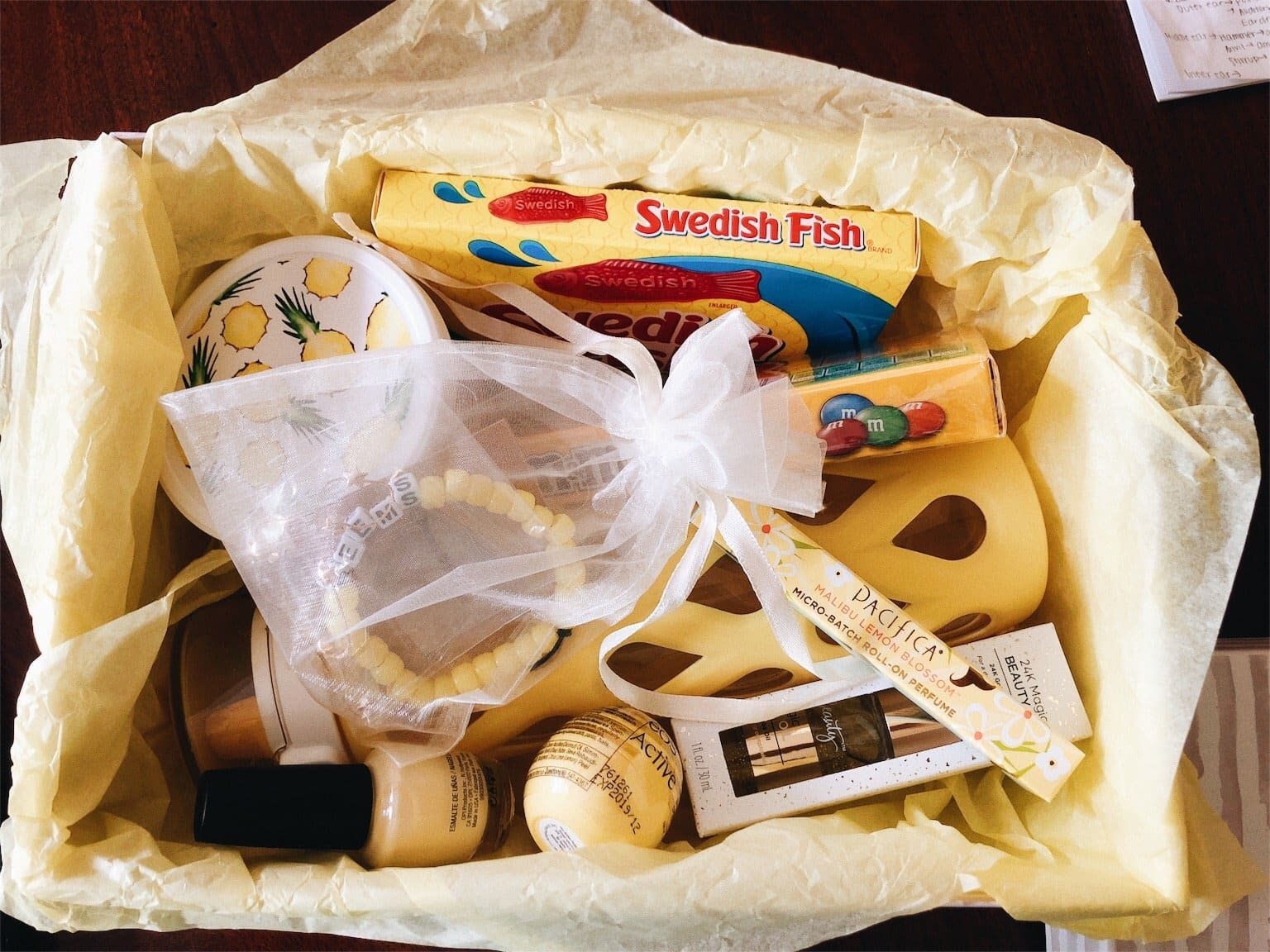 light yellow care package with different yellow gifts inside