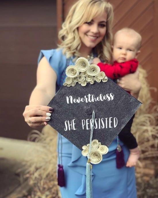 graduating mom holding her decorated cap