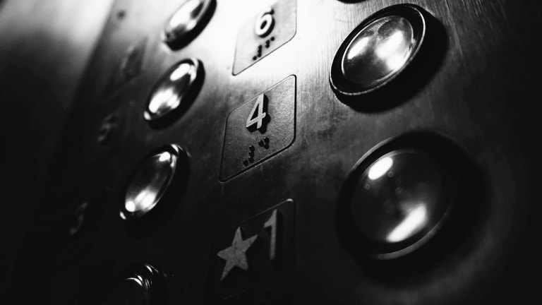 black and white elevator buttons