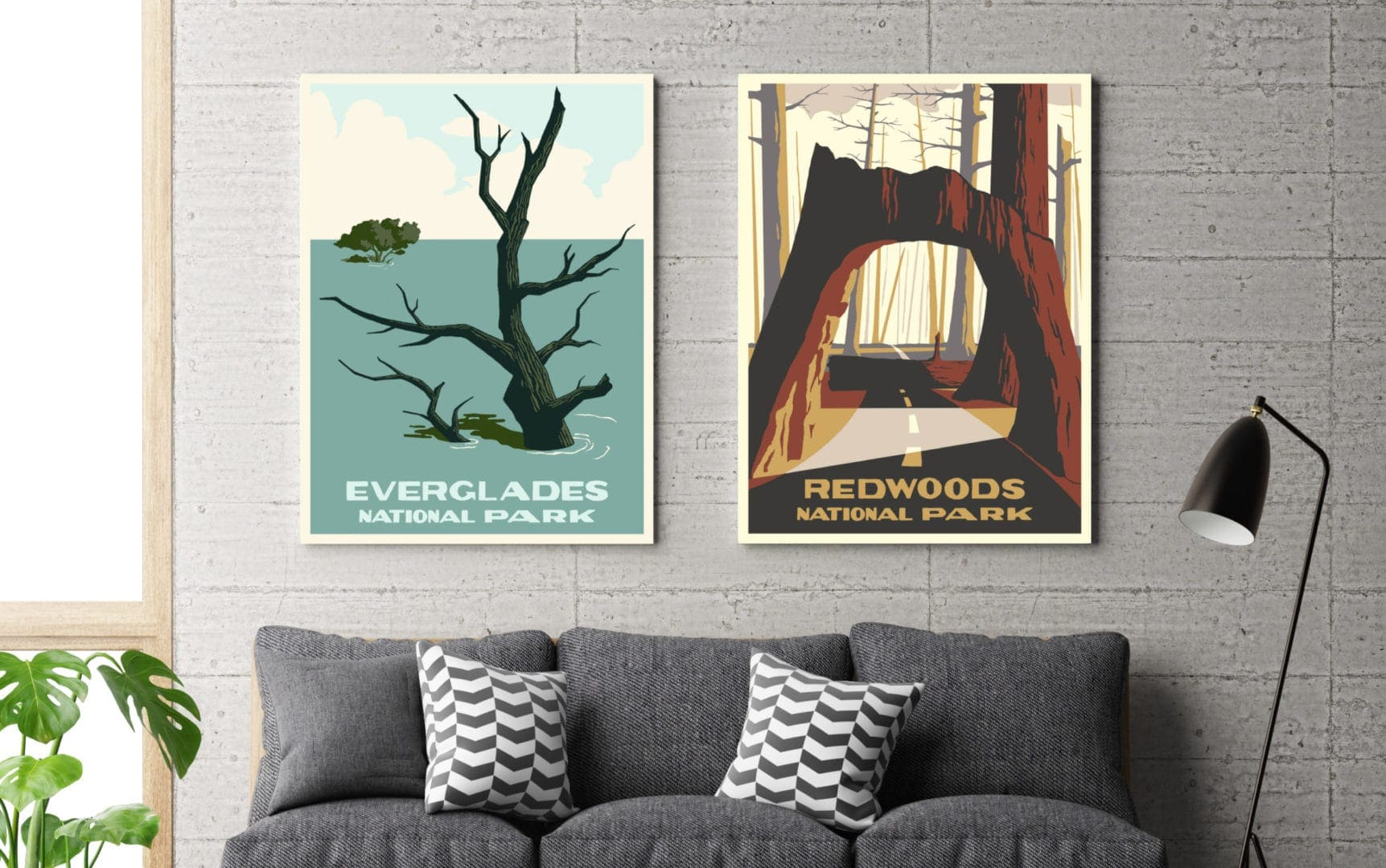 national park posters on white wall with grey couch