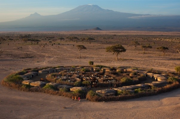 Image: African village with mountain in the distance