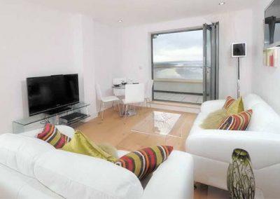 The living area @ 11 Ocean Point, Saunton overlooks Saunton Sands