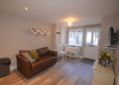 The open-plan living & dining area at 32 Trinity Mews, Torquay