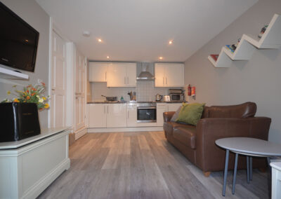 The open-plan living area & kitchen at 32 Trinity Mews, Torquay