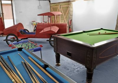 The shared games room at Kettle's On, Higher Churchtown Farm, Tresmeer