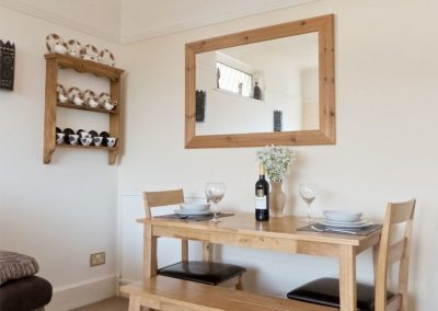 The dining area at The Garden Flat, Moorings Apartments, Torquay