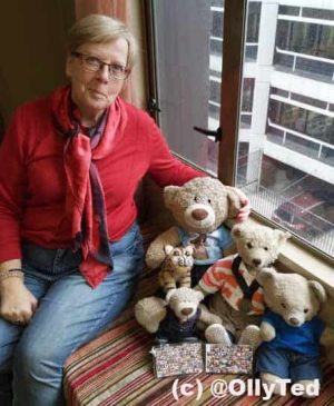 Portrait by a window with teddy bears Taken with a smartphone.
