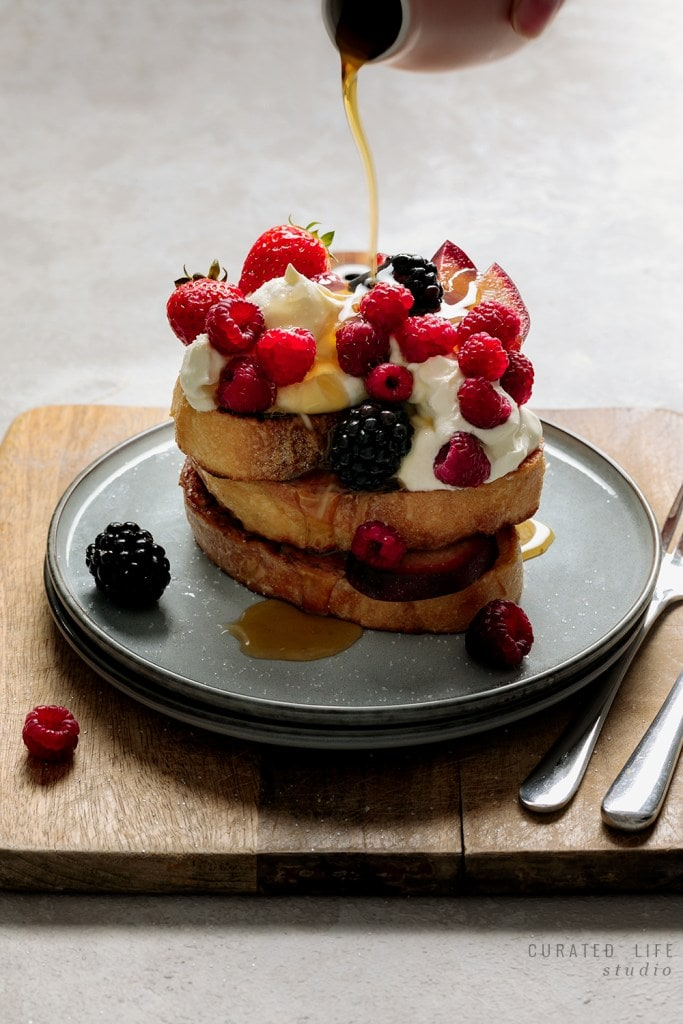 A simple recipe on how to make Homemade French Toast, served with mixed berries & sticky maple syrup.   #French #toast #easy #recipe #best #topping #sweet #curatedlifestudio #breakfast