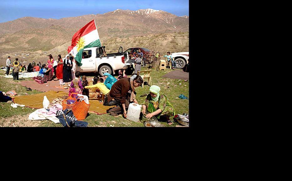 Families set up picnics on Qandil mountain in Sulaimaniyah province during the Nawrooz holiday on March 22, when the picnicking season begins in Iraqi Kurdistan. A Kurdish flag blows in the background.