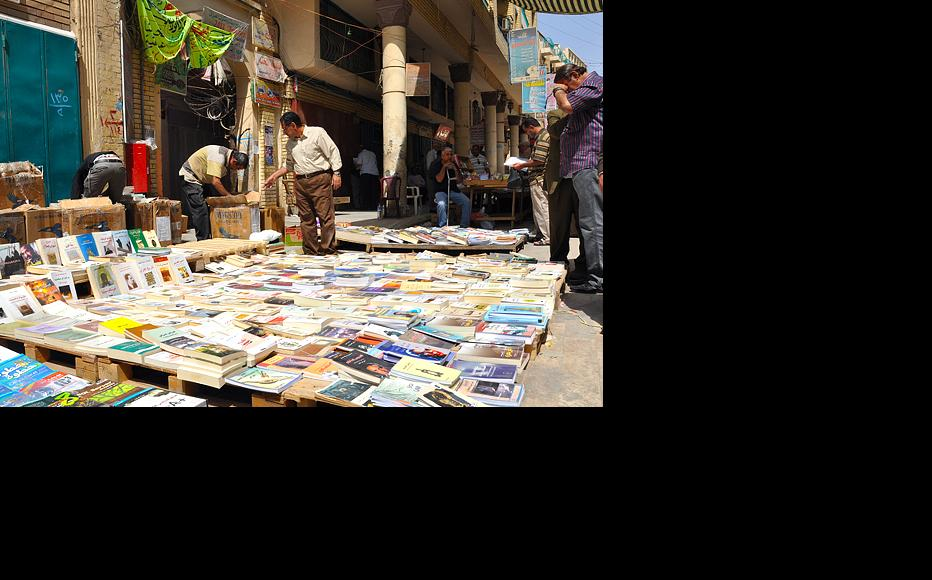 Customers browse for books along Mutanabi street, in an older quarter of Baghdad. The outdoor book market, which draws hundreds of people on Fridays, is a famous hub for intellectuals. After a car bomb ripped through the street in March 2007, killing more than 25 people, the market was closed until late 2008. (Photo: Mariwan Hama-Saeed/IWPR)