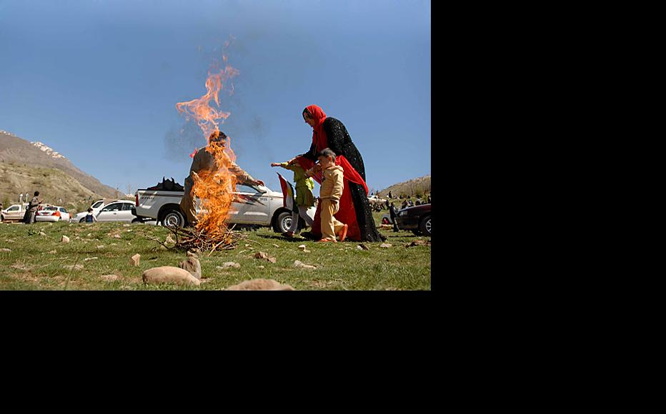 A man builds a fire on Qandil mountain during Nawrooz celebrations. Fire is an important cultural tradition for Kurds honouring Nawrooz.
