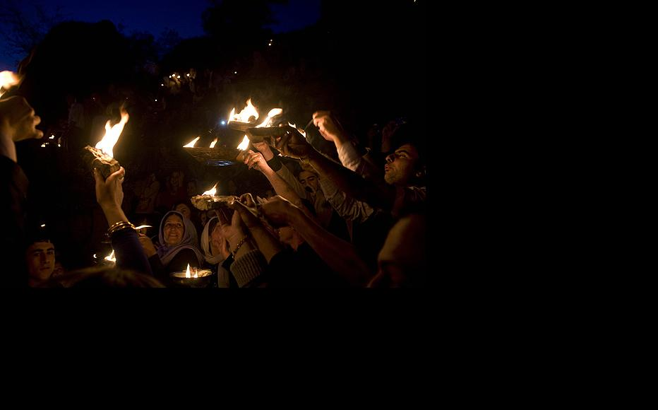 Yezidi hold aloft small oil-burning lamps at sunset on April 14, or Red Wednesday, as the ancient faith calls its New Year celebration. For Yezidi, the New Year is believed to be the start of a new life and a time to restore the spirit.