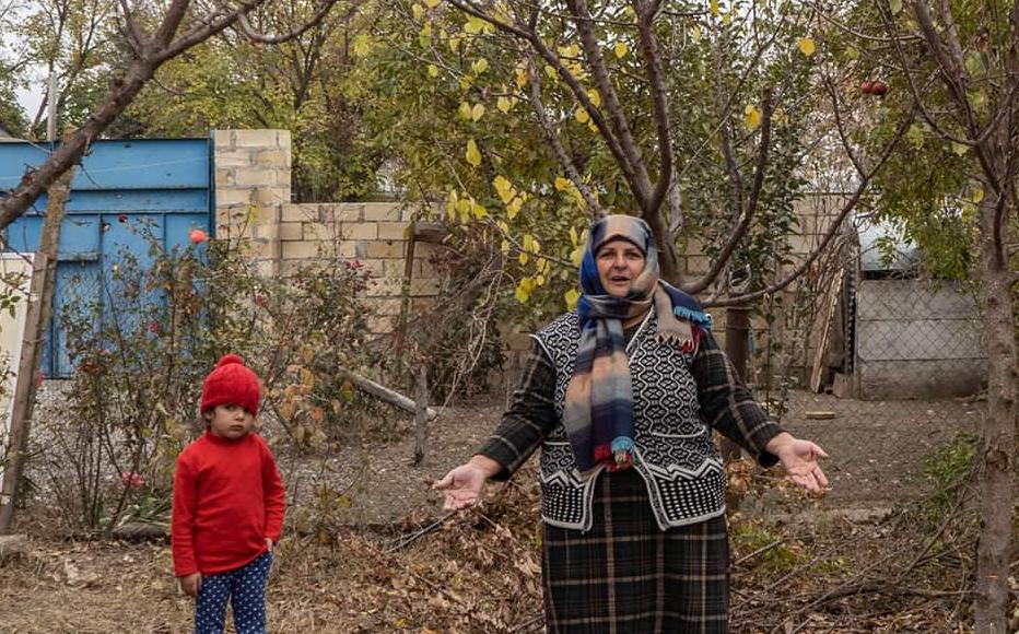 Shahla Gasimova stands in her yard. The house she and her husband built, using her salary as a cleaner at the local school, was destroyed during the war.