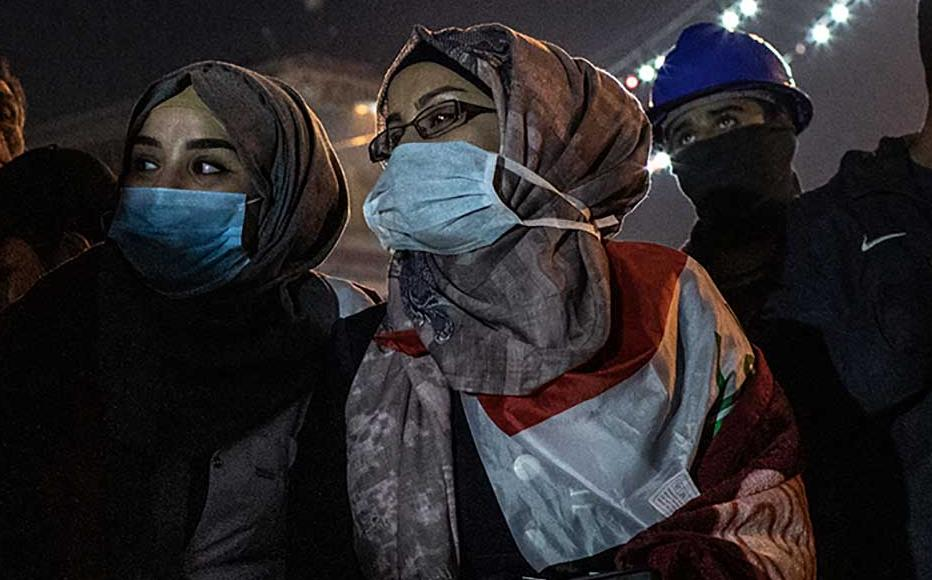 Aya Ameer (L) and her relative Duaa Mohamed during a protest at Tahrir Square in Baghdad.