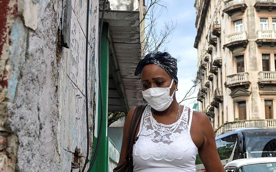 A woman wearing a face mask walks in Havana on September 14, 2020.