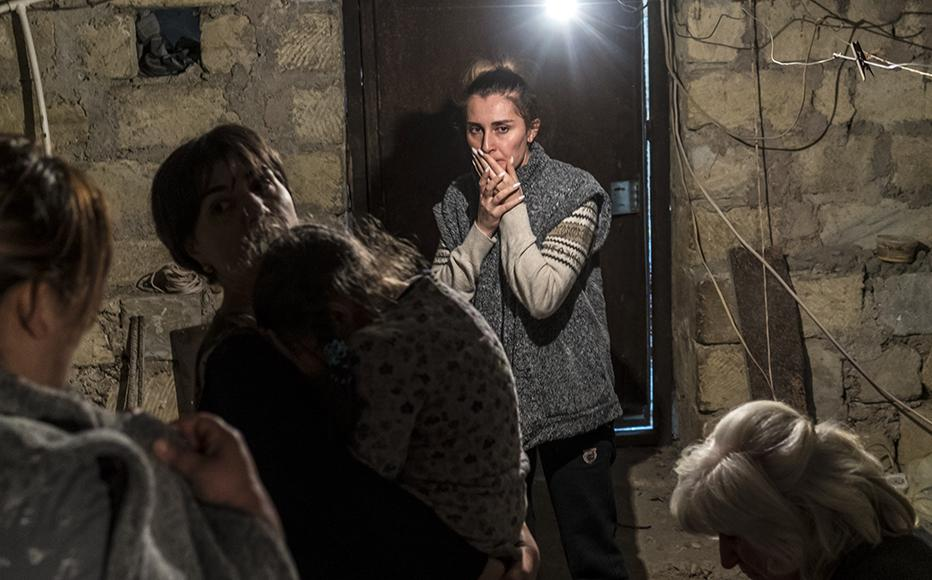 Residents shelter in a basement as air raid sirens sound in Stepanakert, Nagorno-Karabakh. (Photo: Brendan Hoffman/Getty Images)
