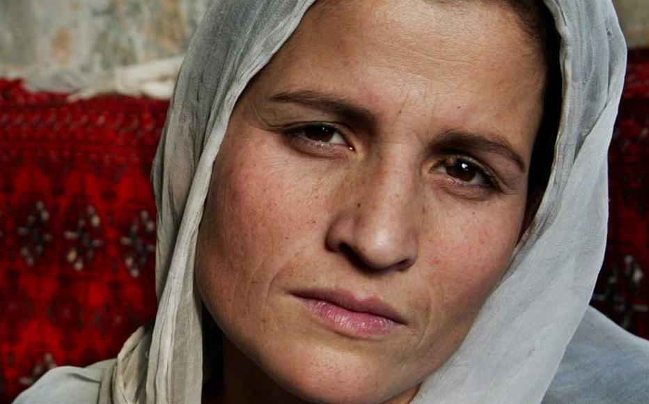 Afghan inmate Jamila, 23, sits in her cell along with another prisoner at the female prison in Kabul, Afghanistan. Jamila has had no trial in any court of law. Her crime was having problems with her husband, who put her in jail.