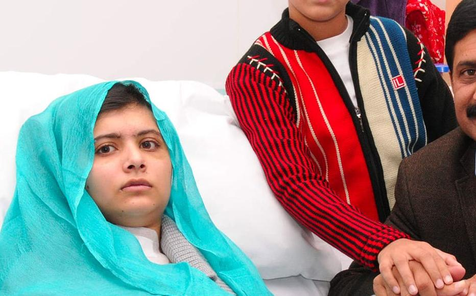 Malala Yousafzai is seen with her father Ziauddin and her two younger brothers, as she recuperates at the The Queen Elizabeth Hospital in Birmingham, October 2012.