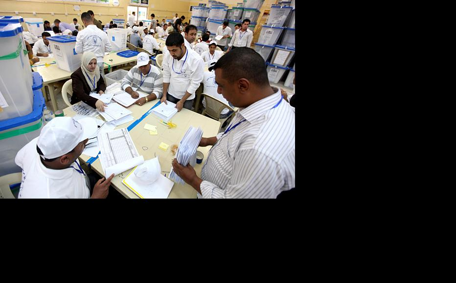 Officials of the Independent High Electoral Commission, IHEC, count votes in Baghdad following national elections held March 7. (Photo: Serwan Azez/Metrography)