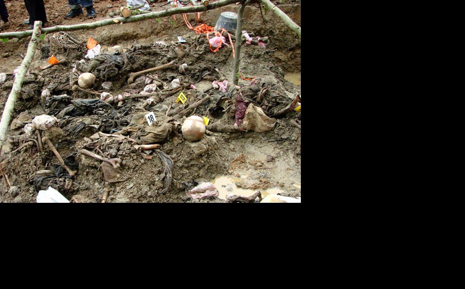 Exhumed grave of Srebrenica victims. Photo: Adam Jones — go.iwpr.info/ajones