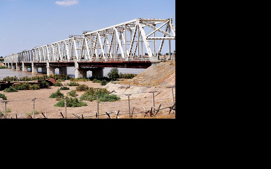 Bridge connecting Afghanistan with Uzbekistan at Hairatan, which is also the location of a refinery processing oil extracted inside the country. (Photo: US Air Force by Staff Sgt. Bradley Lail)