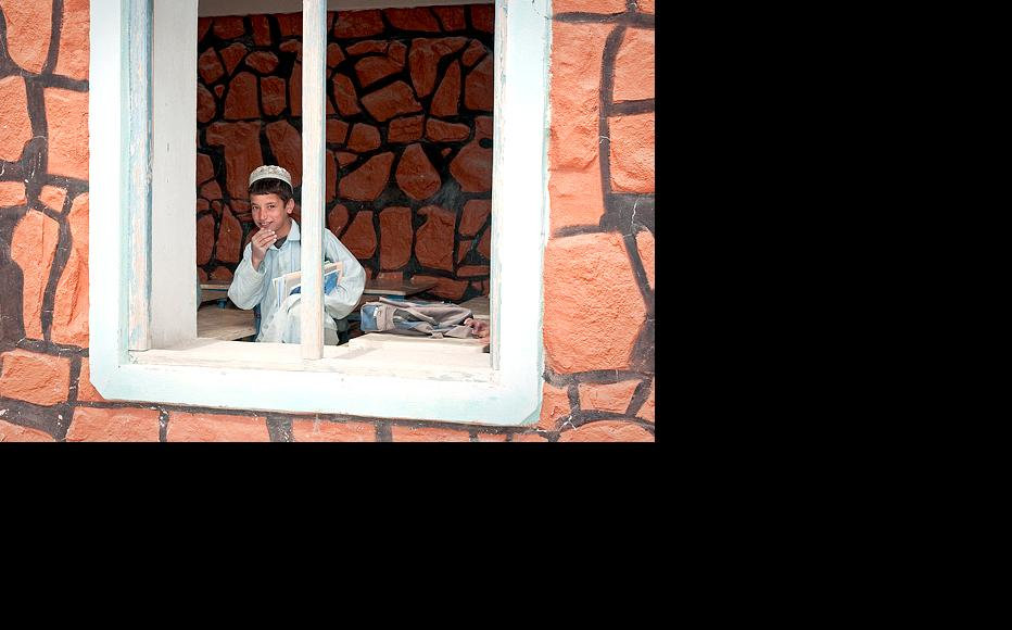 Unlike many, the Ghazikhankel school in Tagab, Kapisa province, has its own building, even if there is no glass in the window yet. (Photo: Isafmedia/US Navy Petty Officer 1st Class Mark O'Donald)