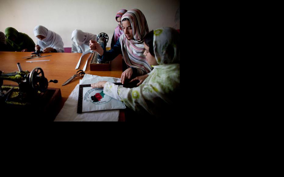 Women learn new skills in workshops in Kabul. (Photo: Majid Saeedi/Getty Images)