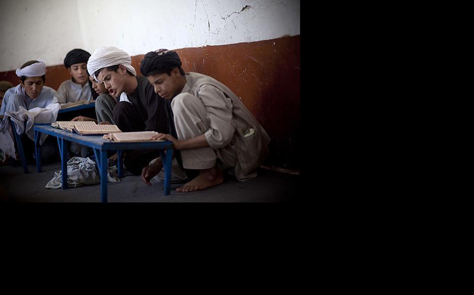 Afghan boys study Koran in a religious school. (Photo: Majid Saeedi/Getty Images)