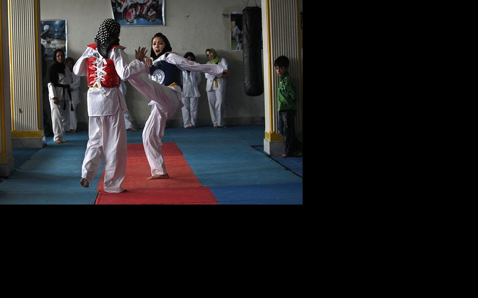 Afghan girls practice martial arts at a gym for women in Kabul. (Photo: John Moore/Getty Images)