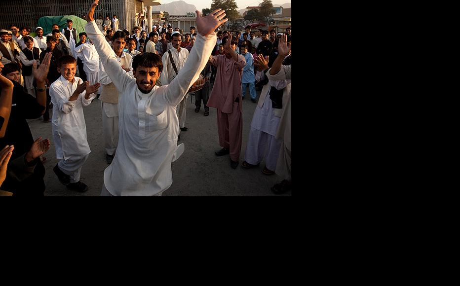Afghan men dance on the streets of Kabul celebrating the first day of Eid-al-Fitr. (Photo: Paula Bronstein/Getty Images)