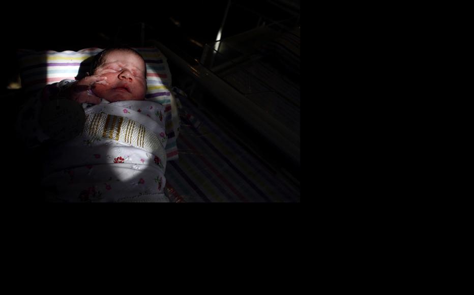A newborn baby sleeps inside the Neonatal ward at a Kabul hospital. (Photo: Paula Bronstein/Getty Images)