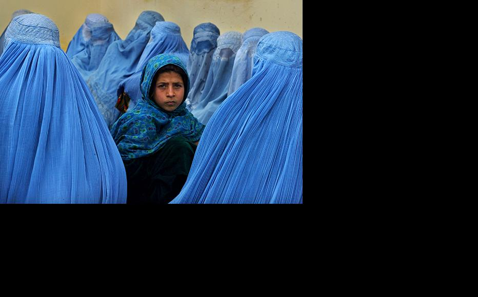 Afghan women wait in line to be treated at a health clinic in Kalakan, Afghanistan. (Photo by Paula Bronstein/Getty Images)