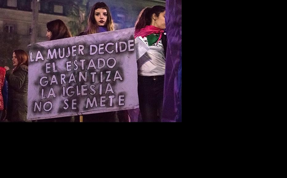 """""""Woman decide. The State warranty. Church: is not your business."""". During a feminist protest in Buenos Aires claiming for the decriminalisation of abortion. (Photo: Wikimedia Commons)"""
