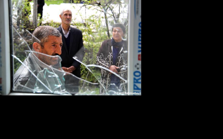 Broken windows in Azad Qaraqoyunlu village. (Photo: Famil Mahmudbeyli)