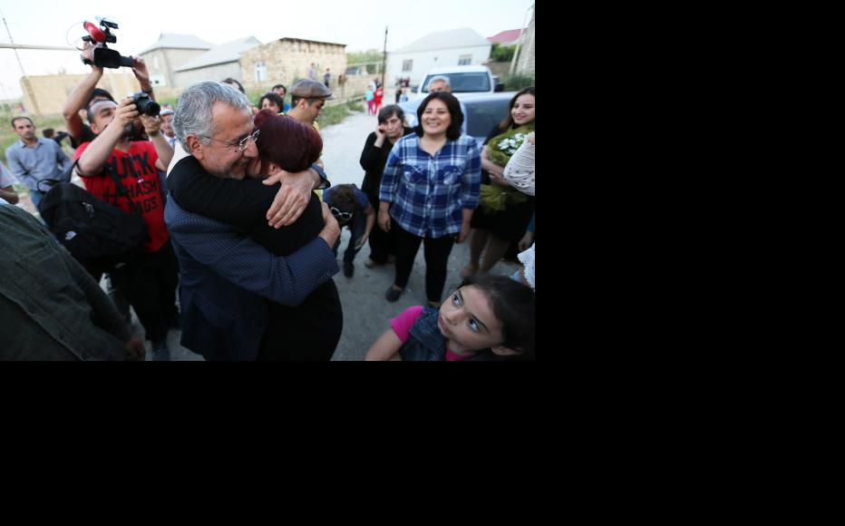Ismayilova embraces Intigam Aliyev, a human rights lawyer and former prisoner of conscience, who was released from prison on March 28. (Photo: Aziz Karimov)