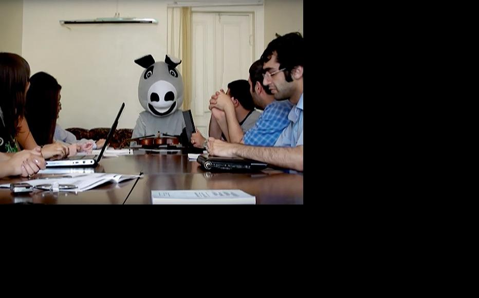 In a satirical video, Mr Heisel (donkey in German) gives a press conference in Baku to an audience of nodding journalists. The parody, which referenced accusations that the government was paying unreasonably high prices to import donkeys, led to the arrests of Emin Milli and Adnan Hajizada. (Still from a video by Olmedia)