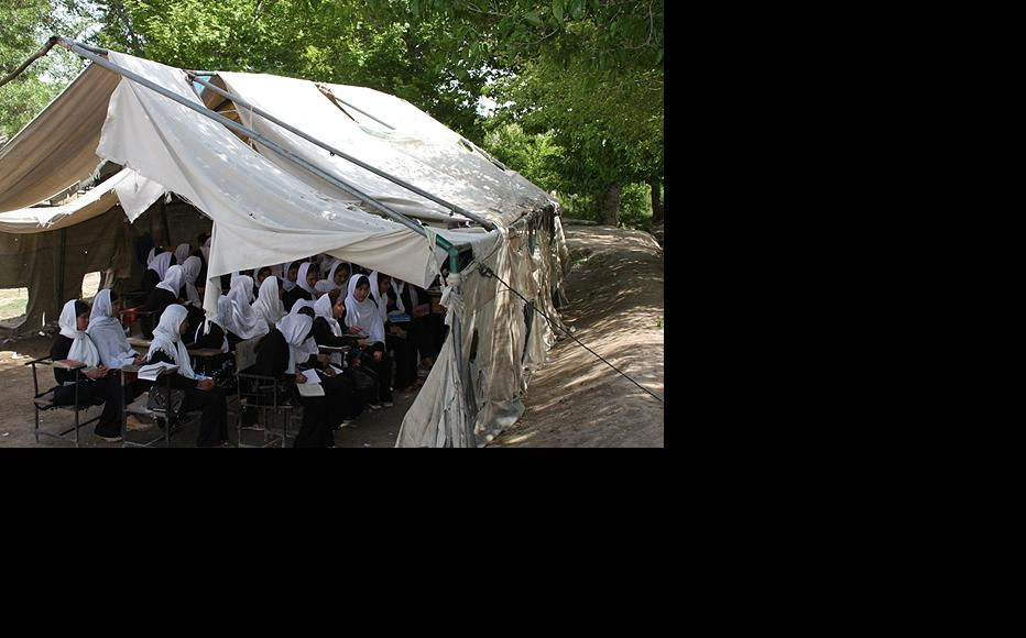 Girls study under canvas at a school in Balkh province. (Photo: Isaf media)