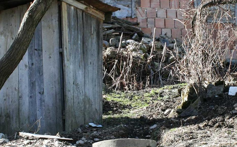 A wooden shack in which one Bosniak villager hid in October 1993, managing to survive.