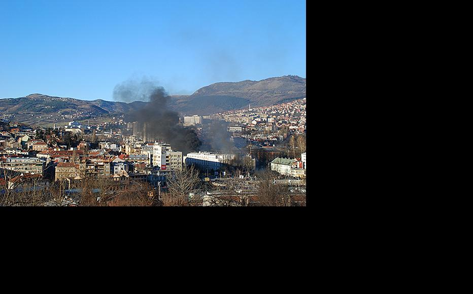 Smoke rises from the centre of Sarajevo. February 7, 2014. (Photo: Jim Marshall)