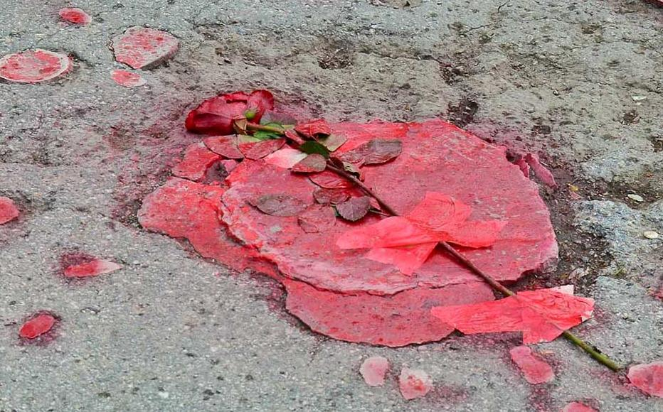The stark red imagery formed a striking yet dignified form of remembrance.