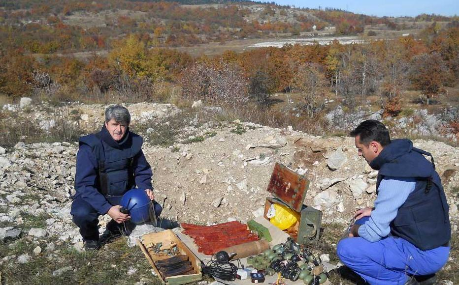 Deminer Stipe Bulic from Livno (on the left) with a colleague in the field.