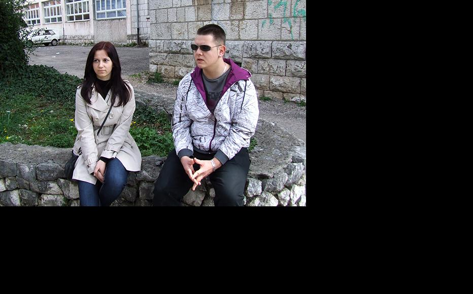 Students Nives Raguz and Edvin Burina in front of their high school in Stolac. (Photo: IWPR)