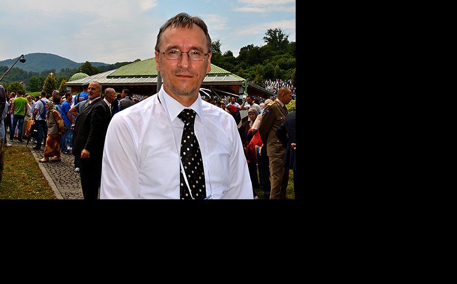 Srebrenica war surgeon Dr Ilijaz Pilav at the ceremony in Potocari commemorating the victims of the 1995 massacre. July 11, 2013. (Photo: IWPR)
