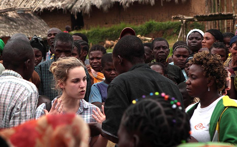 Melanie (centre) and to the right Marie, wearing white, green and yellow top, on assignment in Kibua.