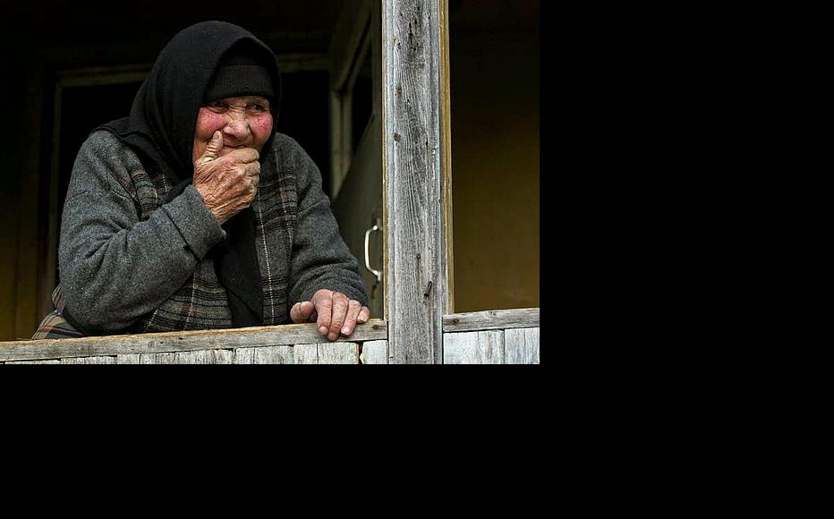 Marta Mgeliashvili, 84, says that officials visited Sharakhevi after the landslide and promised help, but none has been forthcoming. (Photo: Giorgi Kupatadze)
