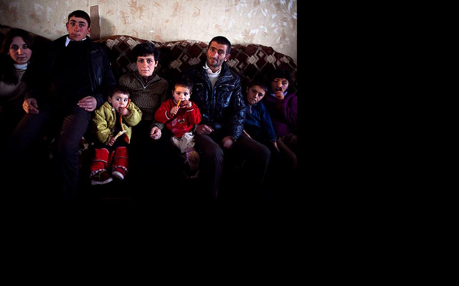 Silva Barkhoyan with her husband and six children. Her four-year-old has a lung condition but the family has no money for treatment. Her 14-year-old daughter had to leave school as she was unable to get there. (Photo: Inna Mkhitaryan)
