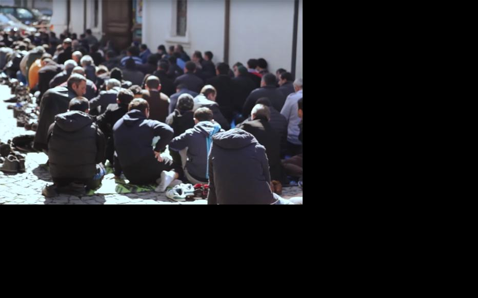 Batumi mosque - prayers sitting in the street because there is no space inside. (Photo courtesy of Beka Tsikarishvili)