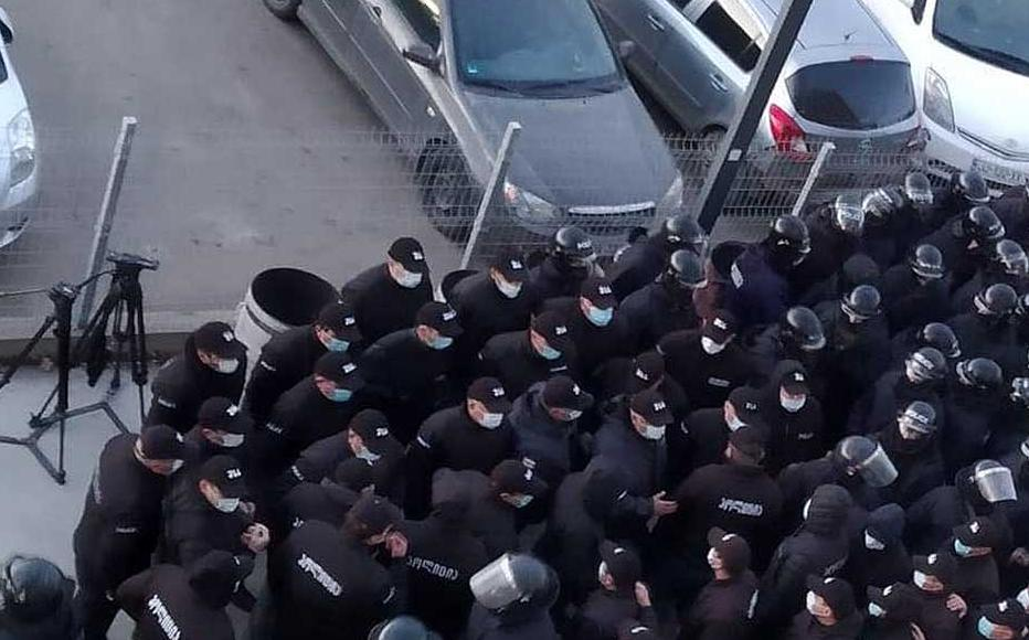 Riot police as seen from the inside of the United National Movement's headquarters before they raided the building to take Nika Melia into custody.