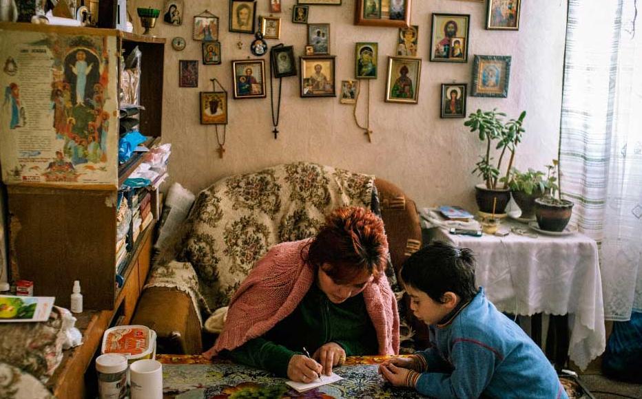 Khatuna Kviria and her son Kakha prepare a shopping list for the week.