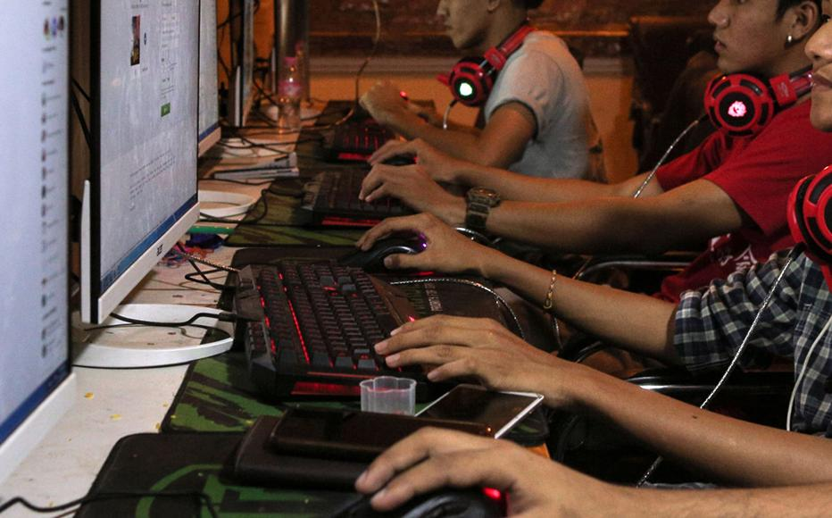 Myanmar youths browsing Facebook pages at an internet shop in Yangon. Facebook has been heavily criticised over failures to control hate speech and misinformation in Myanmar.